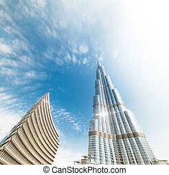 Burj Khalifa vanishing in blue sky in Dubai, UAE. - DUBAI, ...