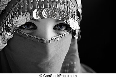 burka - middle eastern culture: belly dancer with...