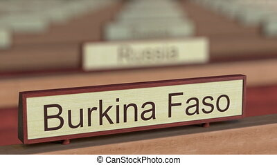 Burkina Faso name sign among different countries plaques at...