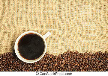 Burlap and coffee beans with cup background