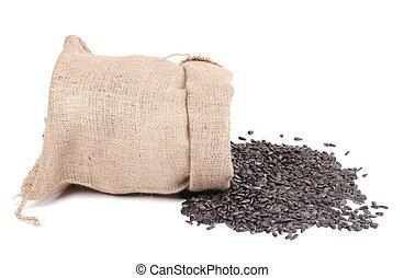 Burlap bag with sunflower seeds.