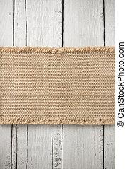burlap hessian sack on wooden background