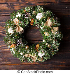 Burlap rustic Christmas wreath with bows and cotton flowers