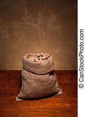 Burlap sack of peanuts