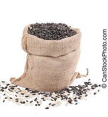 Burlap sack with sunflower seeds.