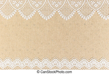 Burlap Texture With White Lace On Wooden Table Background
