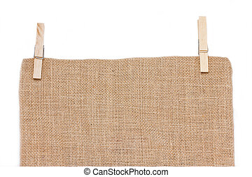 Burlap with wooden clothespin on white background.