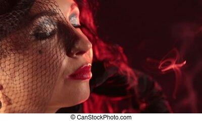 Burlesque style girl smokes a cigar HD