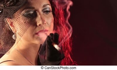 Burlesque style girl smokes a cigar HD