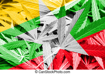 Burma Flag on cannabis background. Drug policy. Legalization...