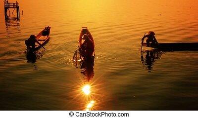 Burma, Inle Lake. Fishermen on the boat show vintage...