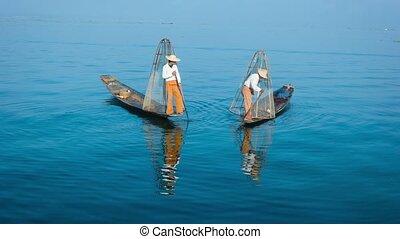 Burma, Inle Lake. The traditional way of fishing. Fishermen...