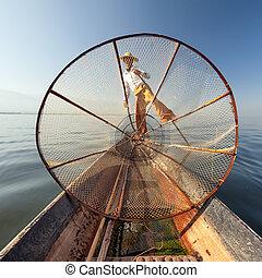 Burma Myanmar Inle lake fisherman on boat catching fish