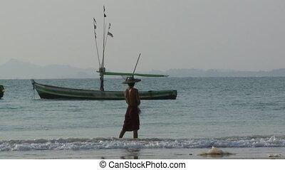 Burmese fisherman at Ngapali Beach, Myanmar - Medium close-...