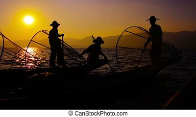 Burmese fishermen after the fishing. Evening on Inle Lake,...