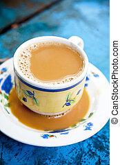 Burmese milk tea on blue table - Burmese milk tea on blue ...