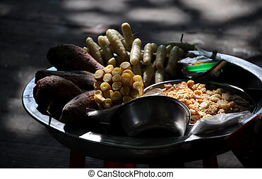 Burmese street snacks - Cooked snacks displayed in a large...