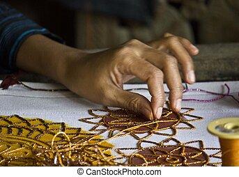 Burmese woman at work sewing beads. - The work of an artisan...