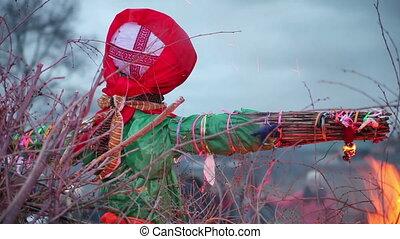 Burn doll on Shrove Tuesday. Russian holiday Maslenitsa. On...
