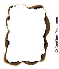 burn paper frame background - close up of burnt paper hole...