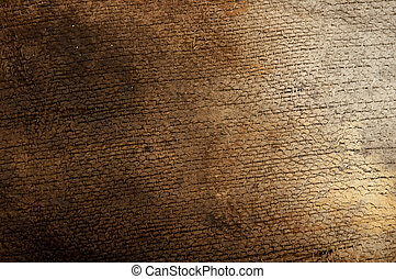 burned burlap on wood background