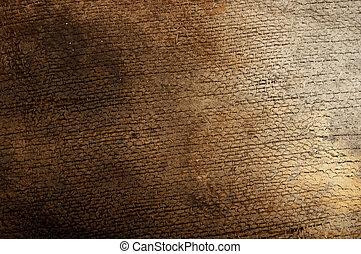 burned burlap on wood background