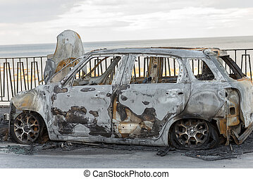 Burned Car Parked on the Street - Small utilitarian car...