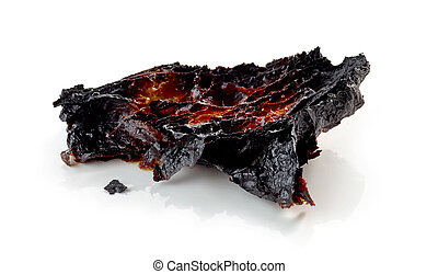 burned croissant on a white background