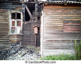 burned-down wooden house