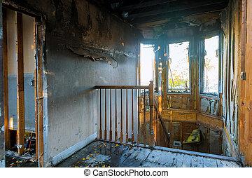 Burned house interior after fire room inside