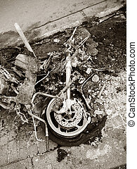 Burned luxury sport motorcycle in Paris France Champs Elysees