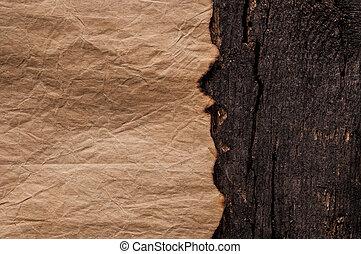 Burned old paper on border wood background