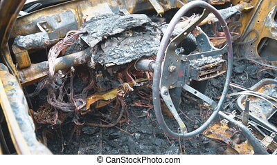 Burned out car after a car accident. Inside view.