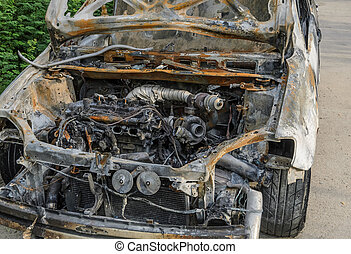 Burned out car after fire