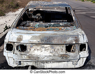 Burned out car in street