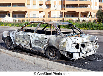 Burned out car in street outdoor