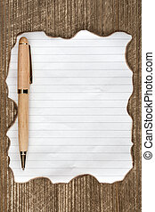 Burned paper sheet with a pen