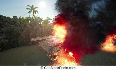 burned tank in the desert at sunset