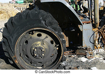 Burned Tractor Detail - A tractor which has been burned down...