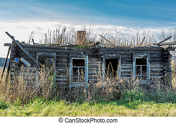 Chopped wooden log cabin burnt in the fire