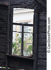 Burned wooden window frame