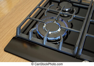 Burners on a black gas cooker