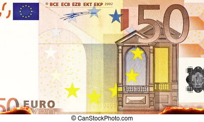 Burning 50 Euro Note - combustion of a 50 Euro note, concept...