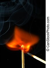 Burning - A match igniting with thin filaments of smoke...