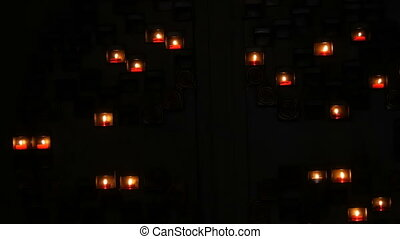 Burning beautiful red round prayer candles in a special ...