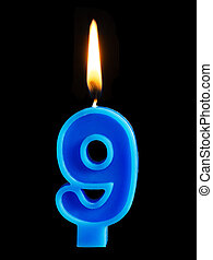 Burning birthday candle in the form of 9 nine figures for...