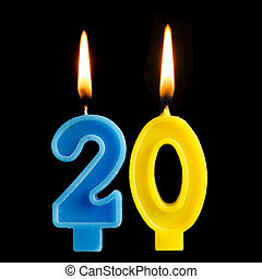Burning birthday candles in the form of 20 twenty figures...