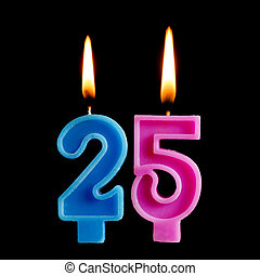 Burning birthday candles in the form of 25 twenty five figures for cake isolated on black background. The concept of celebrating a birthday, anniversary, important date, holiday