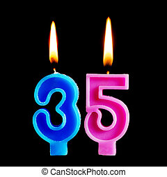 Burning birthday candles in the form of 35 thirty five...