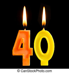 Burning birthday candles in the form of 40 forty figures for...